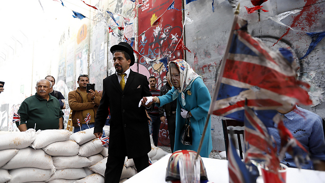 Banksy's West Bank tea part, a British 'apology' for the Balfour Declaration (Photo: EPA)