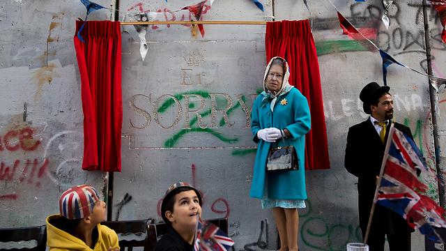 Banksy's West Bank tea part, a British 'apology' for the Balfour Declaration (Photo: AP)