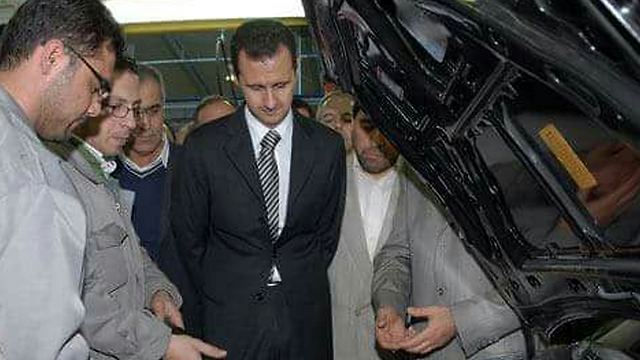 Assad visits the Saipa car factory in the Hisya industrial area