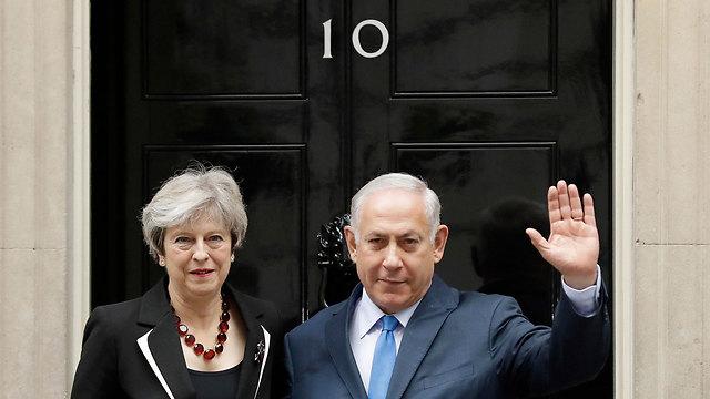 Netanyahu with PM Theresa May (Photo: AFP)