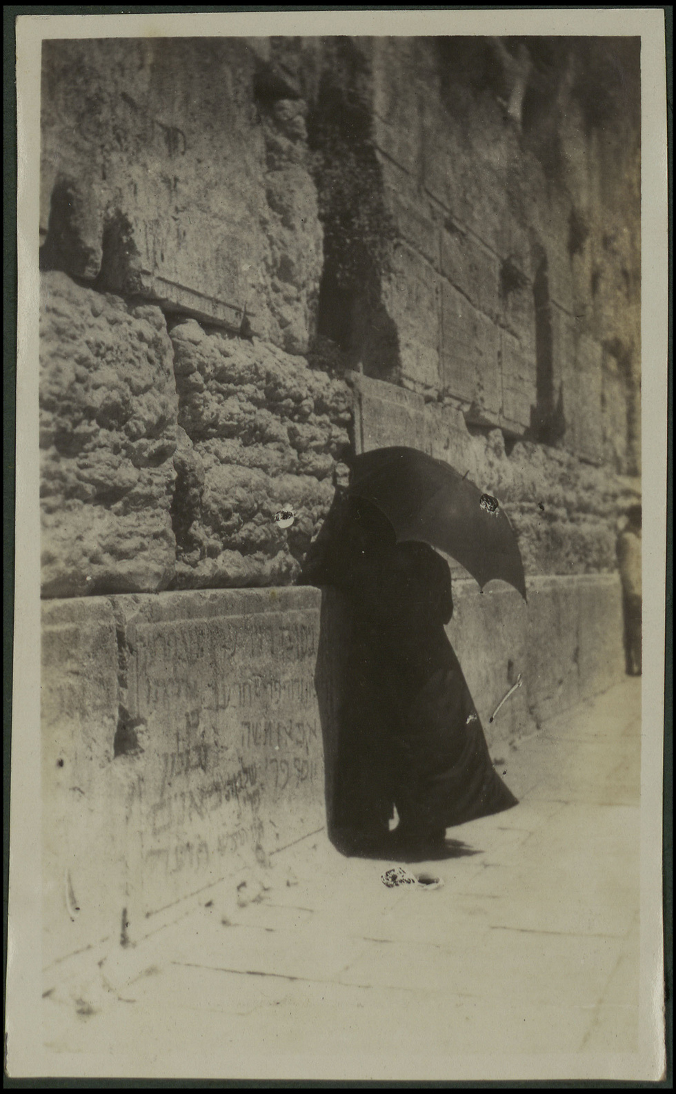 Man praying near Western Wall (Photo: National Library of Israel)