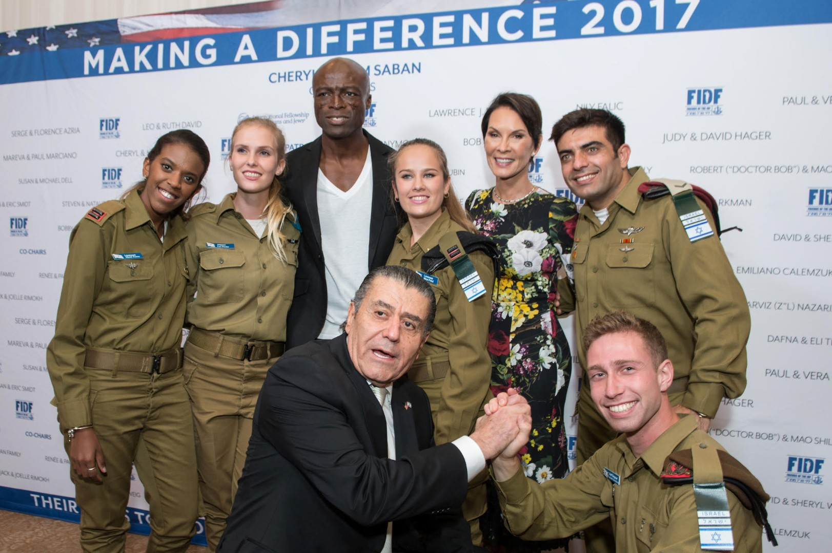 FIDF Narional Board Member Haim Saban, first row on left, and singer Seal with IDF soldiers (Photo: Alexi Rosenfeld)
