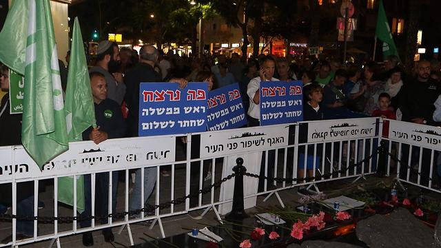 Banners by the Rabin monument stating 'Here was murdered a prime minister who strove for peace' (Photo: Motti Kimchi)