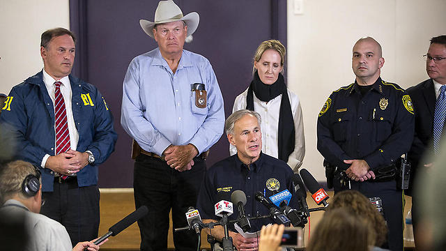Texas Gov. Greg Abbott (sitting) during press conference following shooting