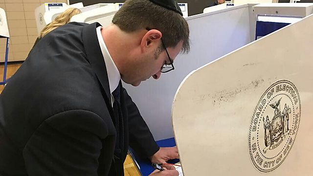 A Satmar follower votes on creating the new town