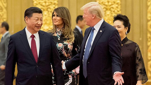 המעורבות האמריקנית הולכת ודועכת בזירות שונות ברחבי העולם. טראמפ ונשיא סין שי (צילום: AFP) (צילום: AFP)