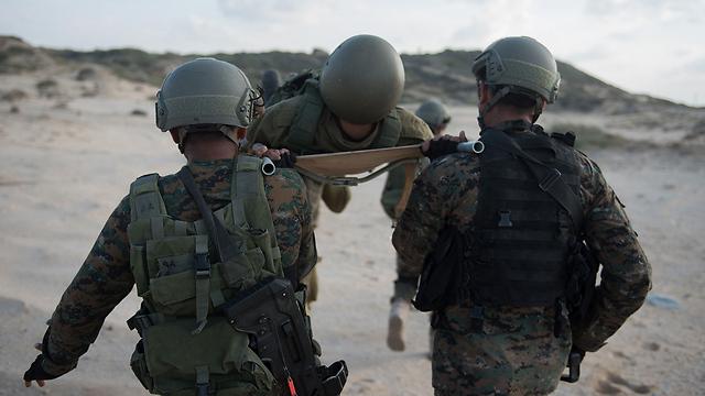 """יתרון לכטב""""ם - מסוגל לנחות בסמוך לפצוע (צילום: דובר צה""""ל) (צילום: דובר צה"""