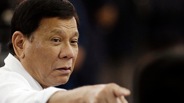 """נשיא הפיליפינים רודריגו דוטרטה. """"בישופים, צאו מהארון"""" (צילום: AP) (צילום: AP)"""