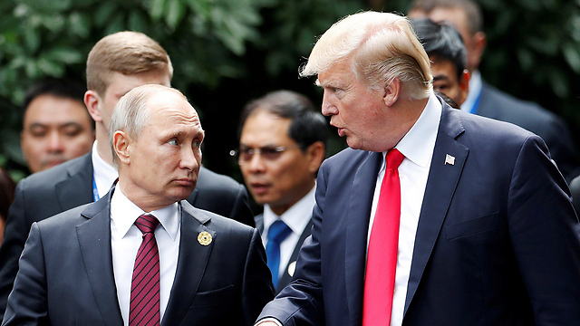 Putin and Trump meeting at the conference on Saturday (Photo: Reuters)
