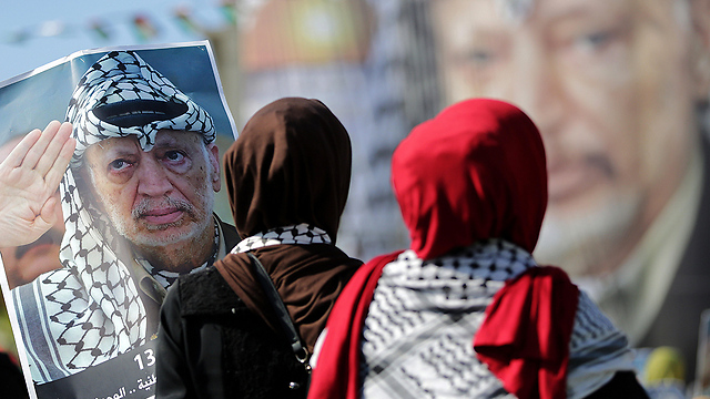 Palestinians commemorating Arafat in Gaza. 'The masses in the strip have always supported Fatah' (Photo: EPA)