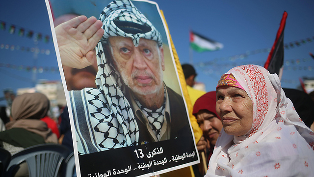A Palestinian woman holds a picture of Arafat at the Gaza rally  (Photo: AFP)