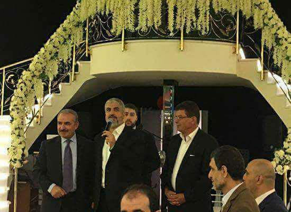 Khaled Mashal (center) at his son's wedding in Istanbul, flanked by senior Fatah man Mohammad Shtayyeh (L)