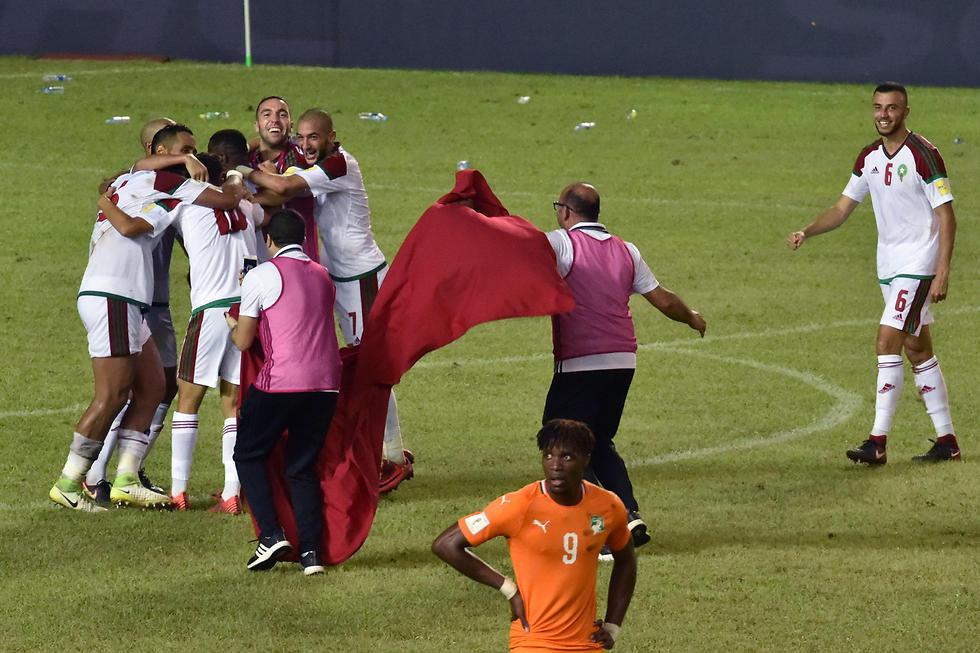 נבחרת מרוקו חוגגת. ארבע נציגות למדינות ערב (צילום: AFP) (צילום: AFP)