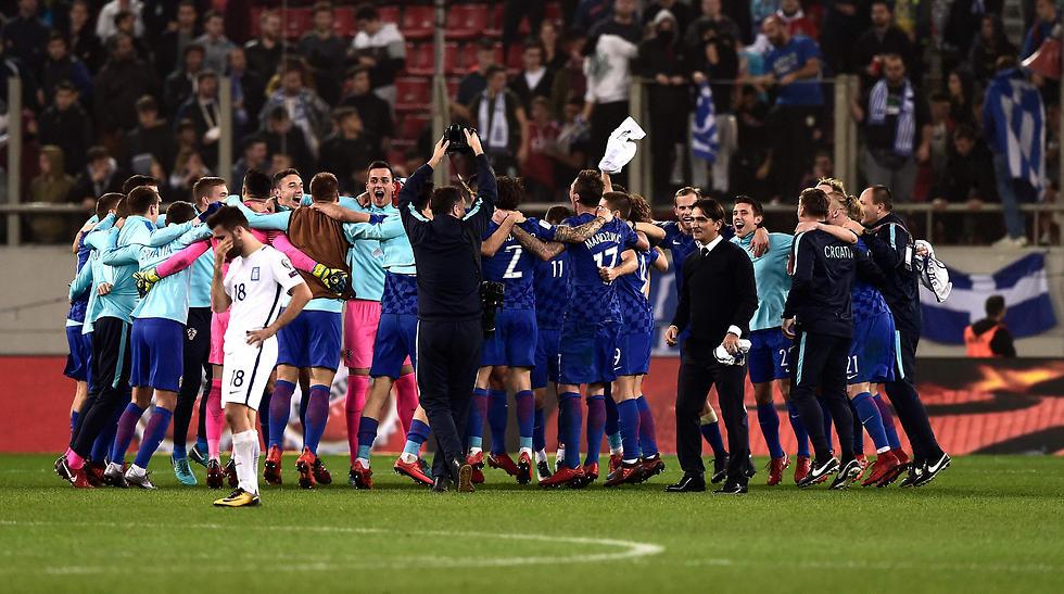 קרואטיה חוגגת את הכרטיס לגביע העולם (צילום: AFP) (צילום: AFP)