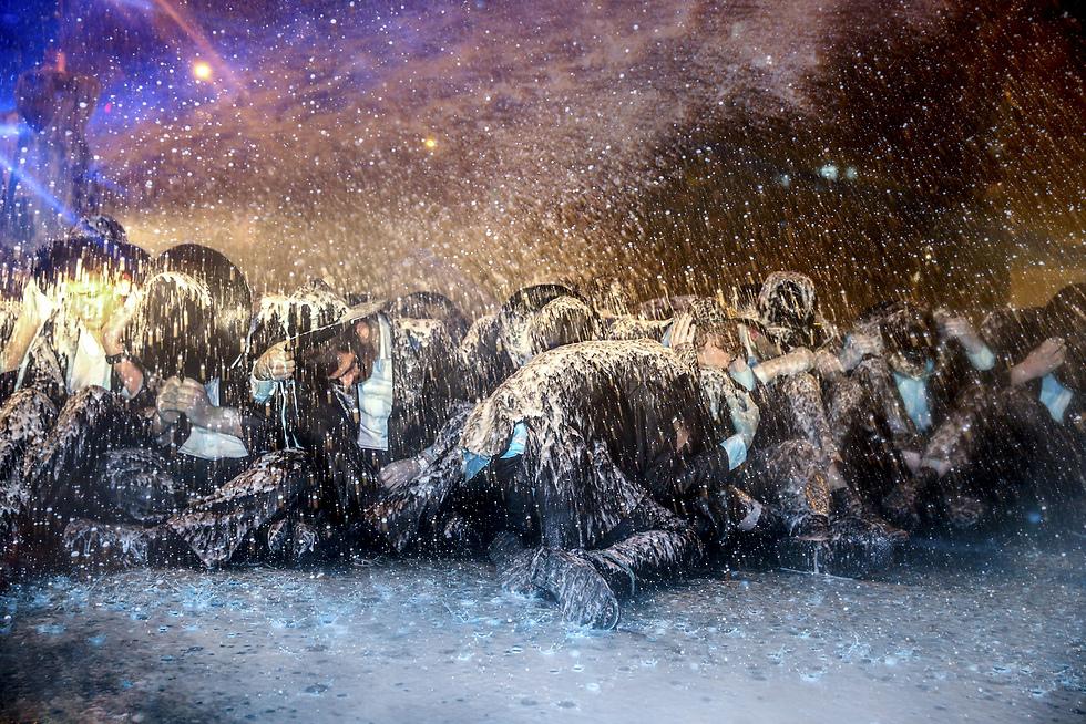 """חרדים מ""""הפלג הירושלמי"""" מפגינים נגד הגיוס לצה""""ל (צילום: אוהד צויגנברג, """"ידיעות אחרונות"""") (צילום: אוהד צויגנברג,"""