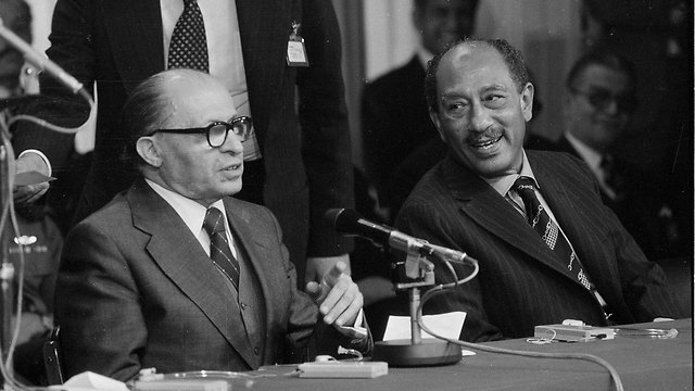 Sadat and Begin after the Knesset speech. 'The decisions were made secretly'  (Photo: AP)
