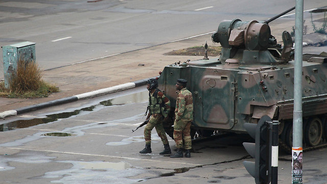 Soldiers and APCs were deployed in Harare (Photo: AP)