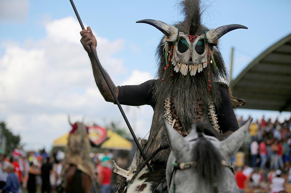 פסטיבל עממי מסורתי בסן מרטין, קולומביה (צילום: רויטרס) (צילום: רויטרס)