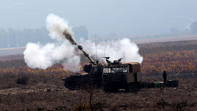 IDF forces near Syrian border in Golan Heights  (Photo: EPA)
