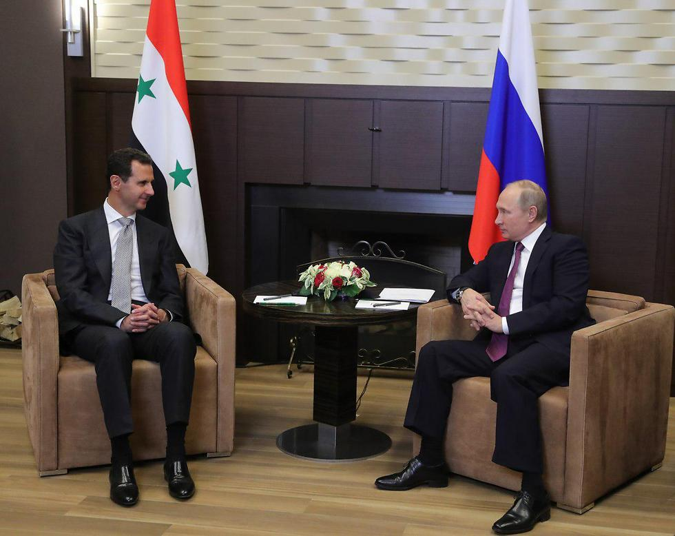 Putin (R) met Assad earlier this week