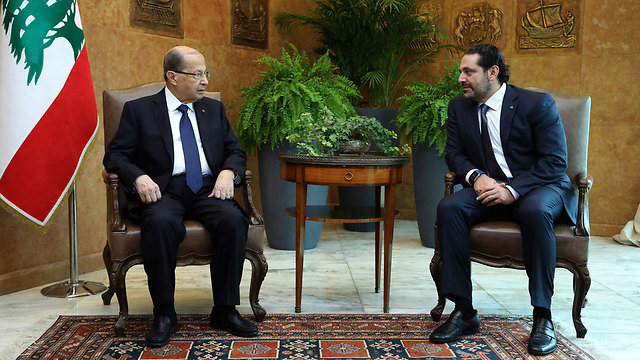 President Michel Aoun (L) with Saad al-Hariri (Photo: AFP)