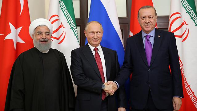 ועידת סוצ'י בהשתתפות רוסיה-טורקיה-איראן השיגה הסכמה על סיום המלחמה בסוריה בדרכי שלום. ארדואן, פוטין ורוחאני (צילום: רויטרס) (צילום: רויטרס)