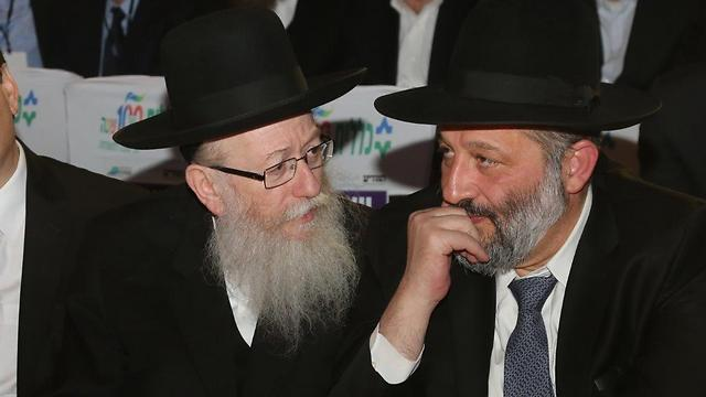 Litzman (L) and Deri. As young Haredim are peeking beyond the wall and adopting what they are finding, their politicians are growing weaker  (Photo: Motti Kimchi)