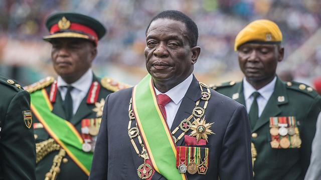 """זכה לכינוי """"הקרוקודיל"""" בשל אכזריותו במהלך מלחמת העצמאות. נשיא זימבבואה החדש אמרסון מנאנגאגווה (צילום: AFP) (צילום: AFP)"""