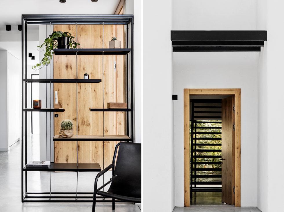 הבית מאופיין בשימוש בברזל, בטון ועץ, ובצבעוניות תואמת. גרם המדרגות מול דלת הכניסה (מימין) עשוי פלדה, כמו הקורות שמעליה. הספרייה הקלילה שמפרידה בין המבואה לסלון (בתמונה משמאל) משלבת ברזל ועץ   (צילום: איתי בנית)
