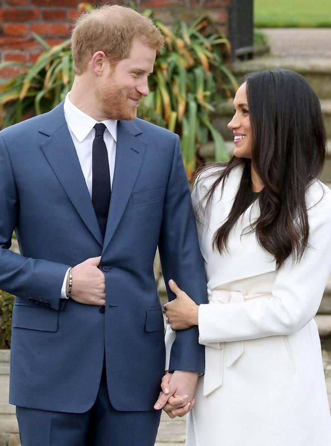 """ברור שהיא אמרה """"איי דו"""". מייגן מרקל והנסיך הארי (צילום: Gettyimages)"""