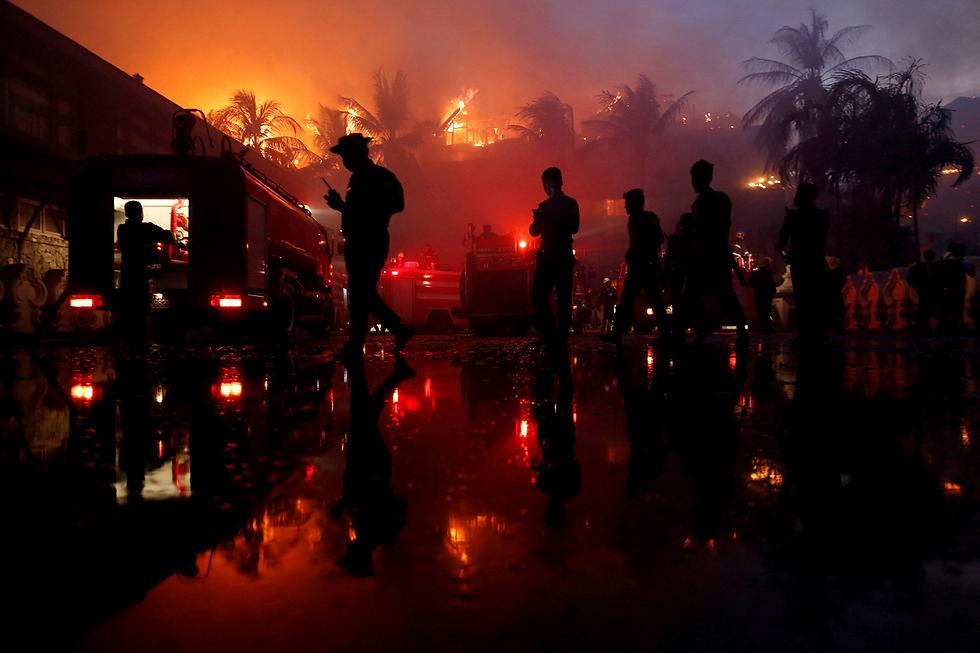 שריפה לילית במלון ביאנגון, מיאנמר (צילום: רויטרס)