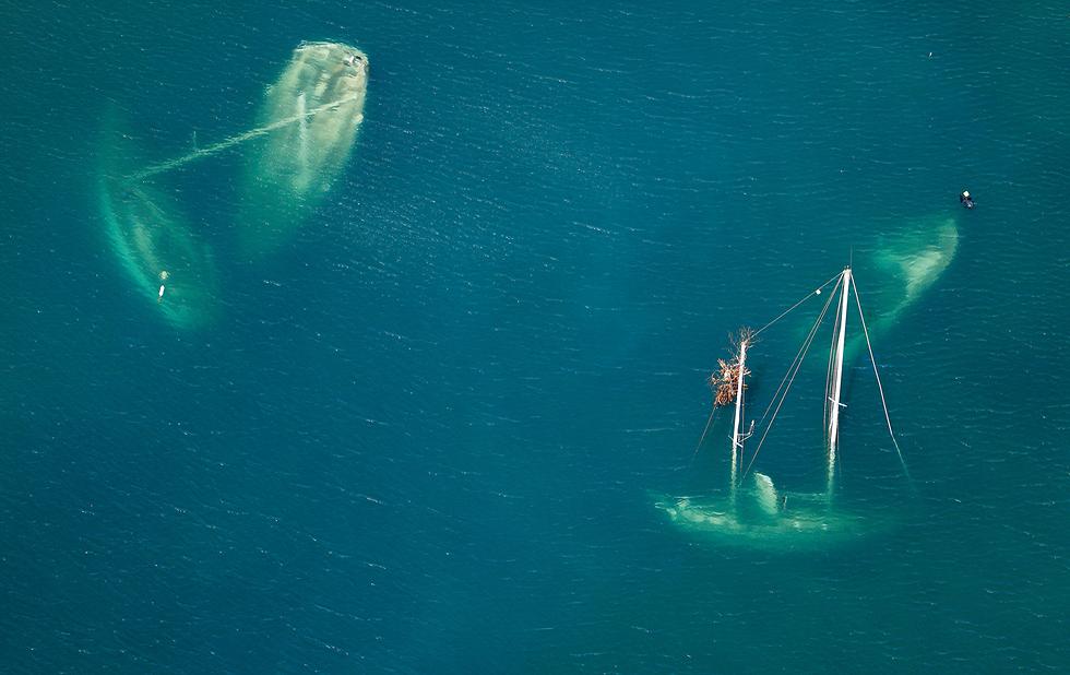 """סירות טובעות במהלך הוריקן """"אירמה"""" בארה""""ב (צילום: רויטרס)"""