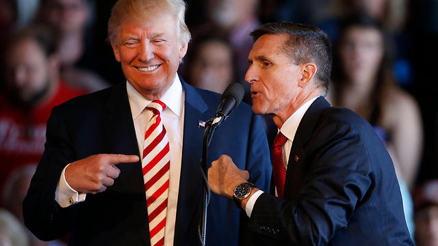 Trump with former national security adviser Michael Flynn (Photo: AFP)