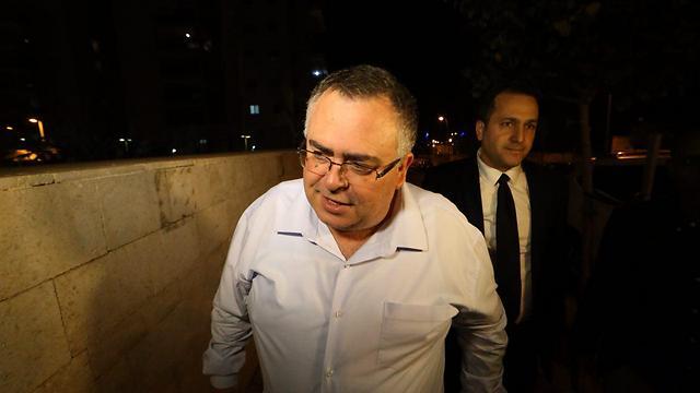 Bitan, returning home Sunday night after 14 hours of interrogation (Photo: Motti Kimchi)