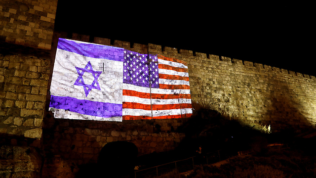 The walls of the Old City illuminated with the American and Israeli flags (Photo: Reuters)