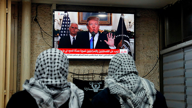 East Jerusalem residents watch Trump's speech (Photo: AFP)