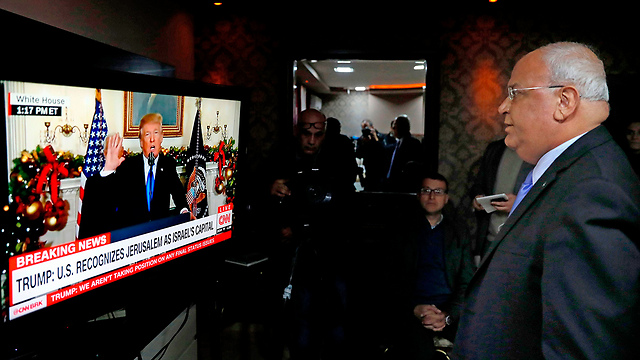 Palestinian negotiator Erekat watching Trump's announcement (Photo: AFP)