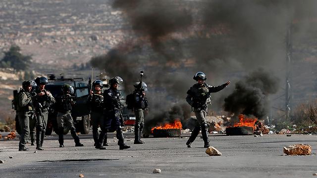 התפרעויות בביתוניא (צילום: AFP)