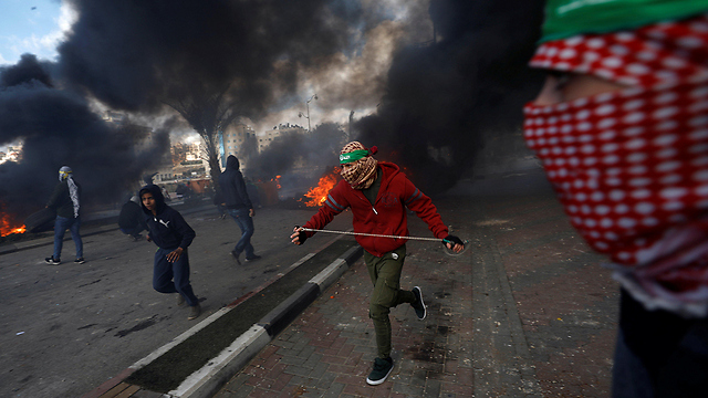 Clashes in Ramallah over Trump's declaration (Photo: Reuters)