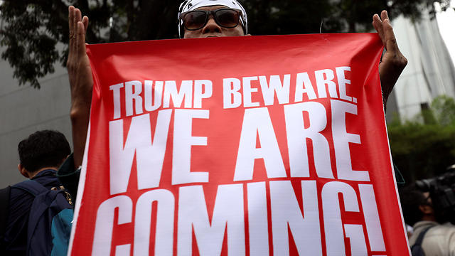 Anti-Trump protests in Malaysia (Photo: Reuters)