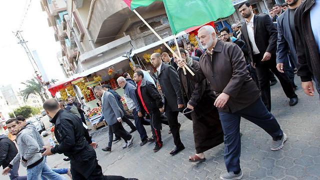 Haniyeh, Hamas officials marching in Gaza