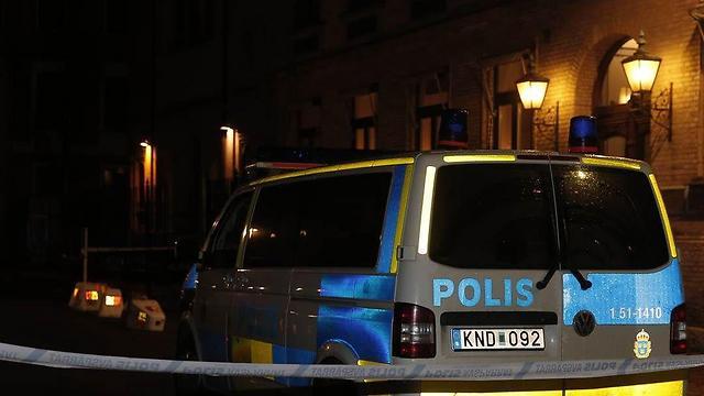 Swedish police at the scene of the arson attack