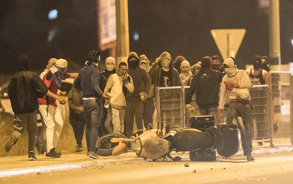 Nechushtan's bike ditched as angry mob tears through the street (Photo: Gil Nechushtan)