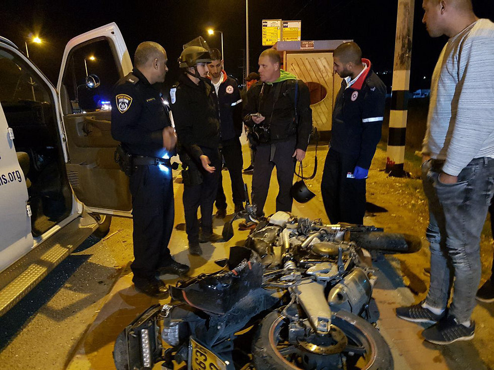 Nechushtan (center) and his destroyed bike