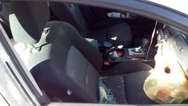 The inside of the car hit by rocks in Gush Etzion (Photo: Ma'ale Amos Security)