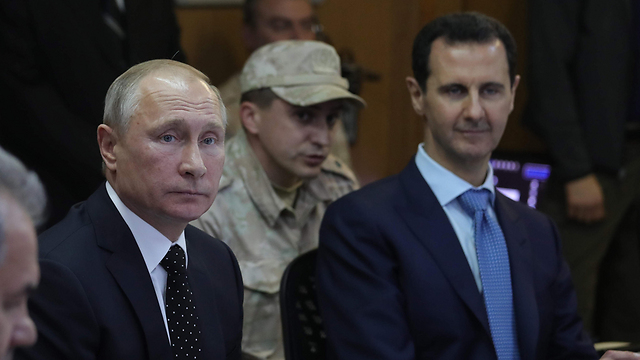 Russian President Vladimir Putin (L) with Syrian President Assad (Photo: AP)
