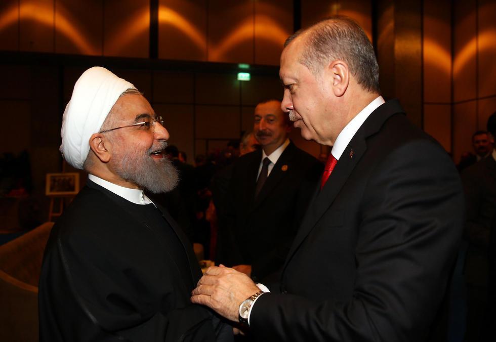 Erdogan, right, welcomes Rouhani (Photo: EPA)