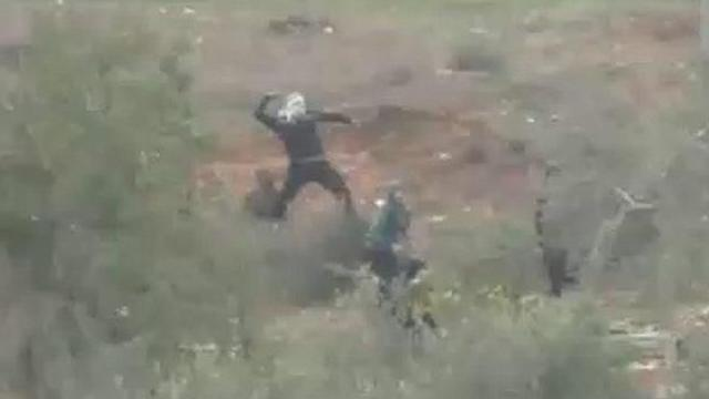Settlers throwing stones in Burin, Nablus
