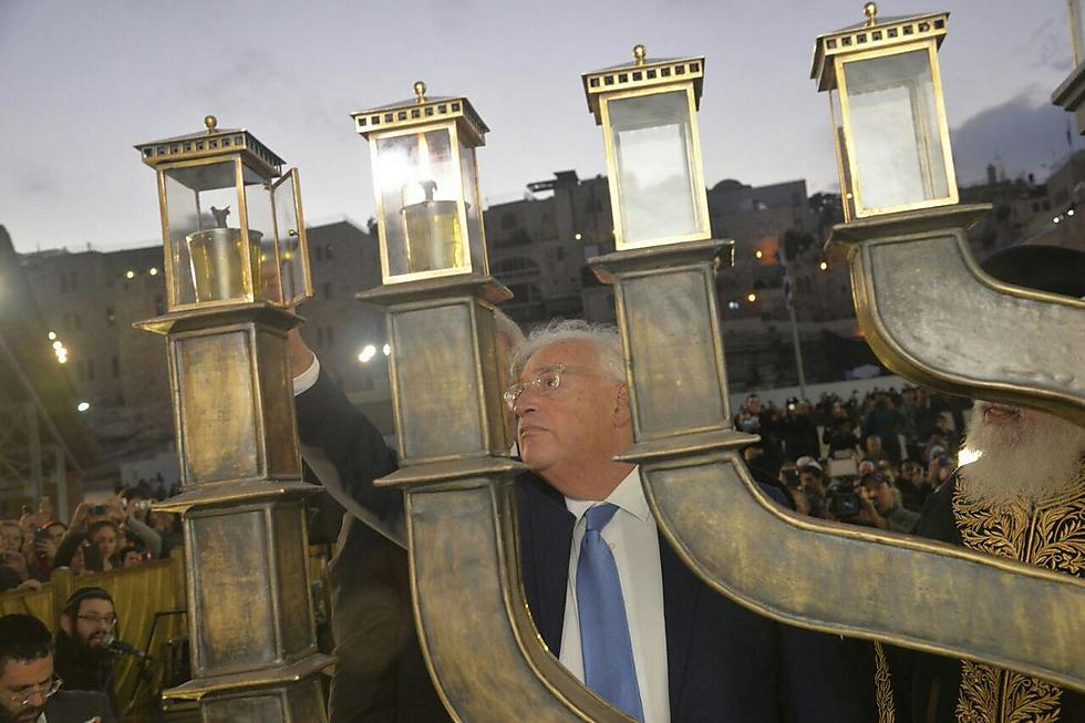 Ambassador Friedman lights the menorah at the Kotel (Photo: The Western Wall Heritage Foundation)
