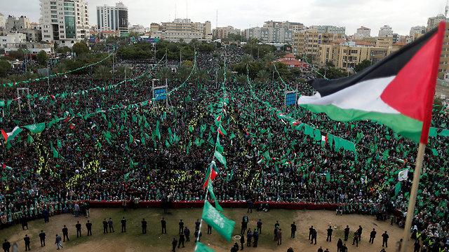 עצרת יום השנה ה-30 לייסוד חמאס, היום בעזה (צילום: רויטרס) (צילום: רויטרס)